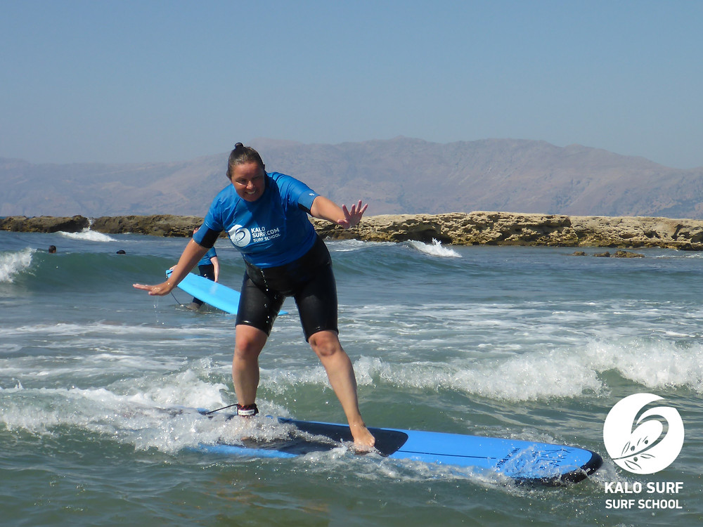 female surfer riding a wave in Kissamos