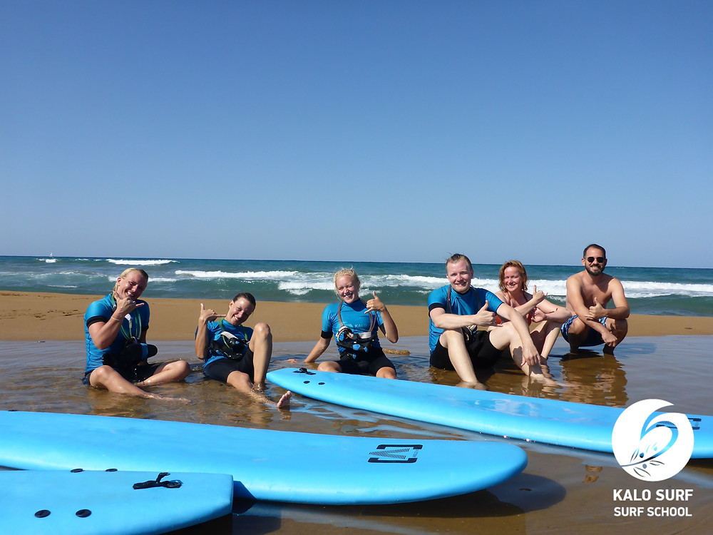 Surfing in Crete, group picture, surf lesson, surf board