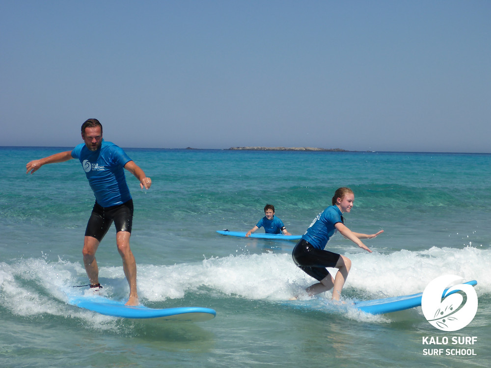 two surfers share wave Falassarna Crete