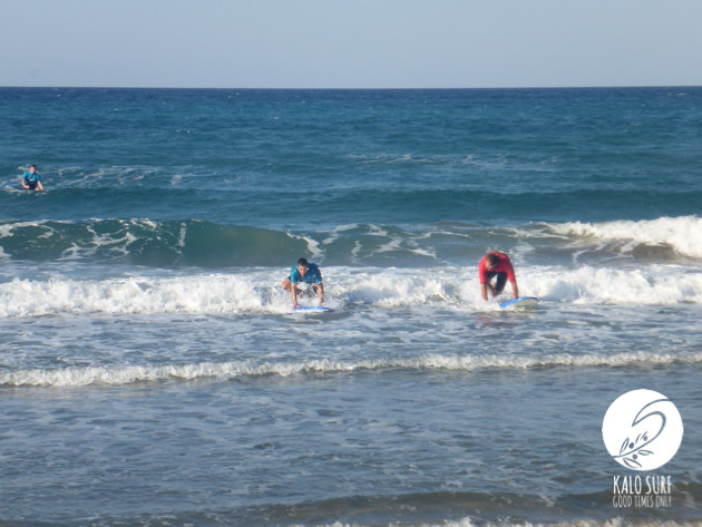 two surfers popping up in Greece