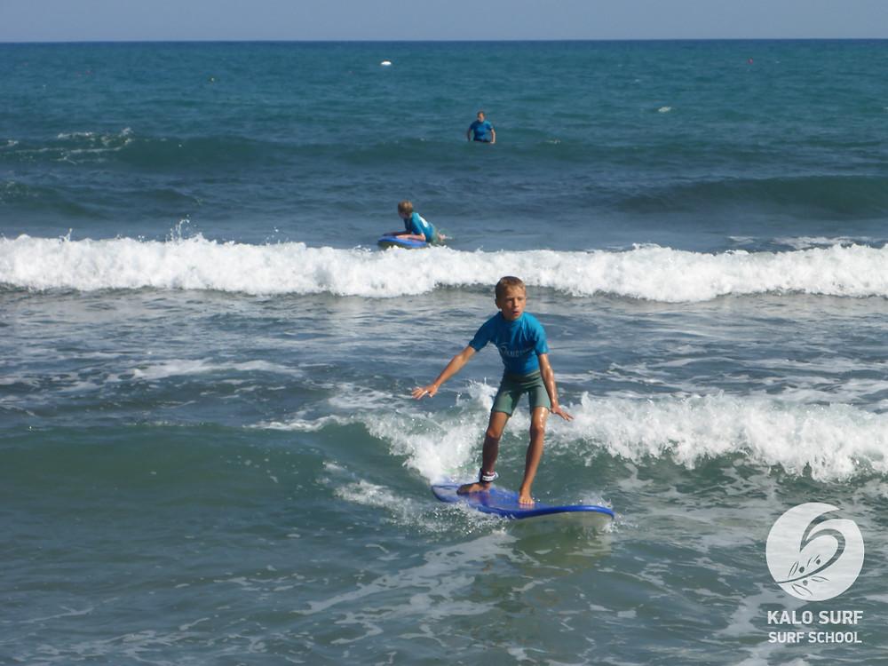 beginner surf lesson in Crete, kids surfing