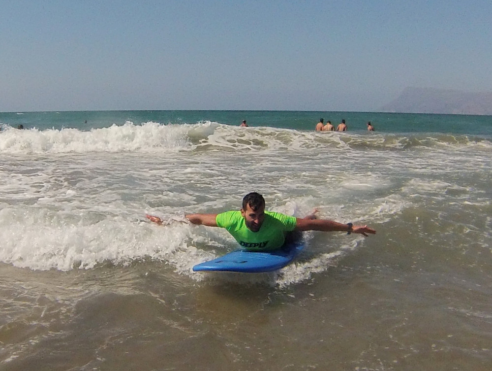 surf student glides on first wave