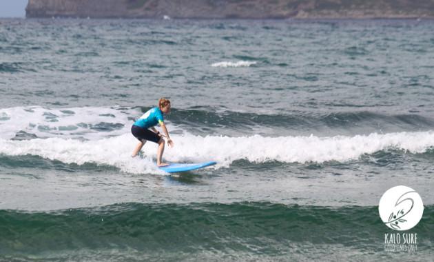 surfer girl in reef break falassarna