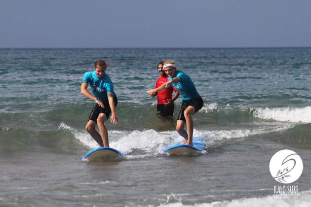 two guys learn surfing in kissamos