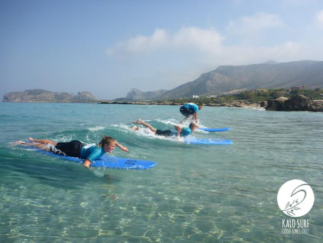 surfers taking off in Greece