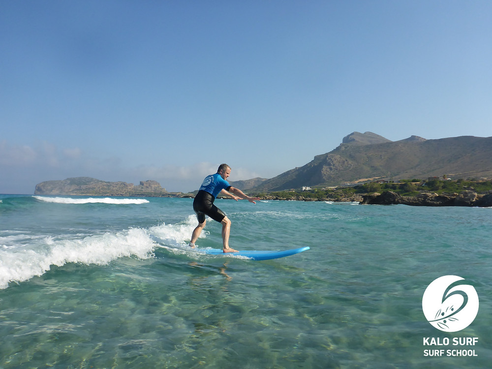 surfing riding a wave in Falassarna