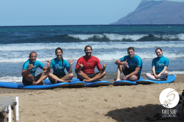 Group picture beach kissamos on surfboards