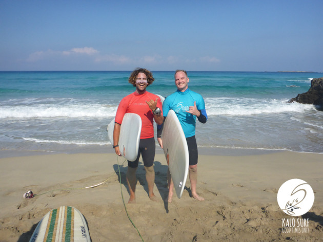 Surfers posing with surfboards in Crete