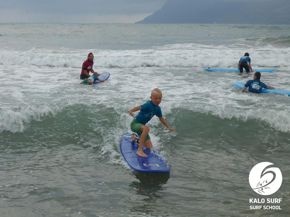 8 year old surfer, pop up, surfboard, waves, Crete