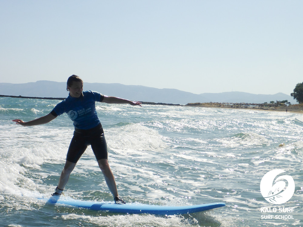 surfer learning to surf in Crete