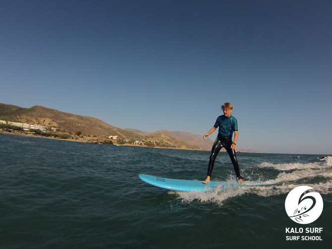 Paddling out to catch waves in Kissamos