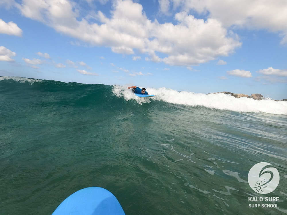 paddling into the wave, intermediate surf lesson
