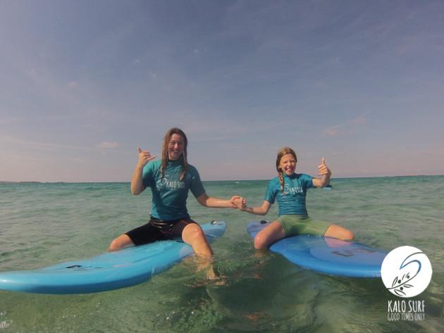 women surfing in Crete, surboard, wetsuit