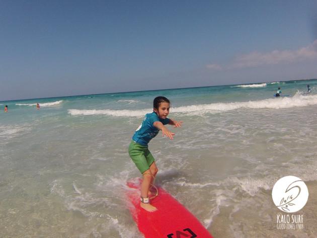 kid surfing in Crete
