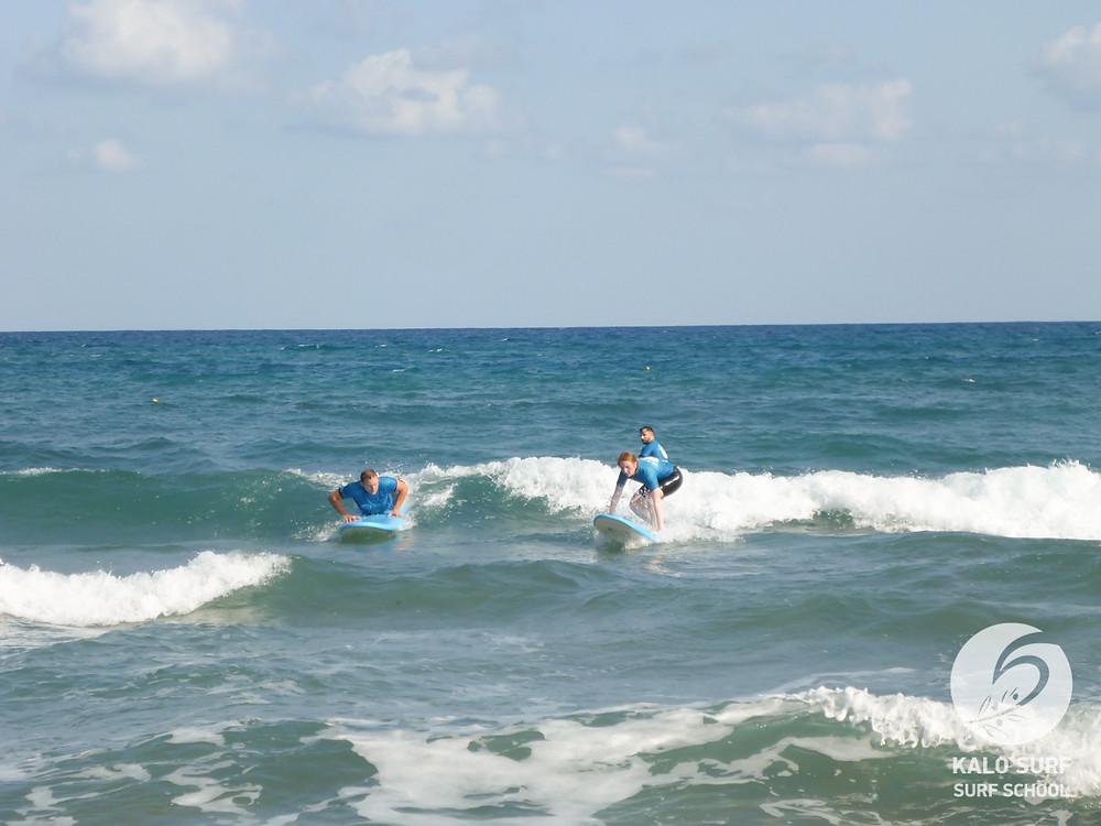 surf lesson Crete, surfboard, wetsuit, waves