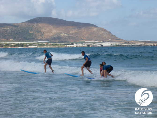 Catching waves and surfing in August in Greece