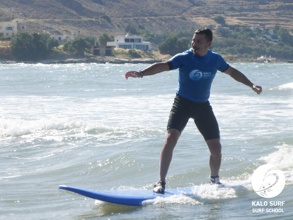 surfer smiling riding a wave in Kissamos