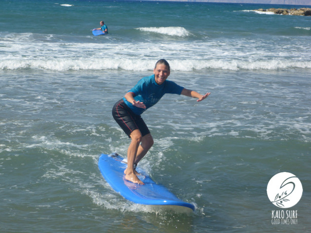 surfer riding waves in Kissamos Crete