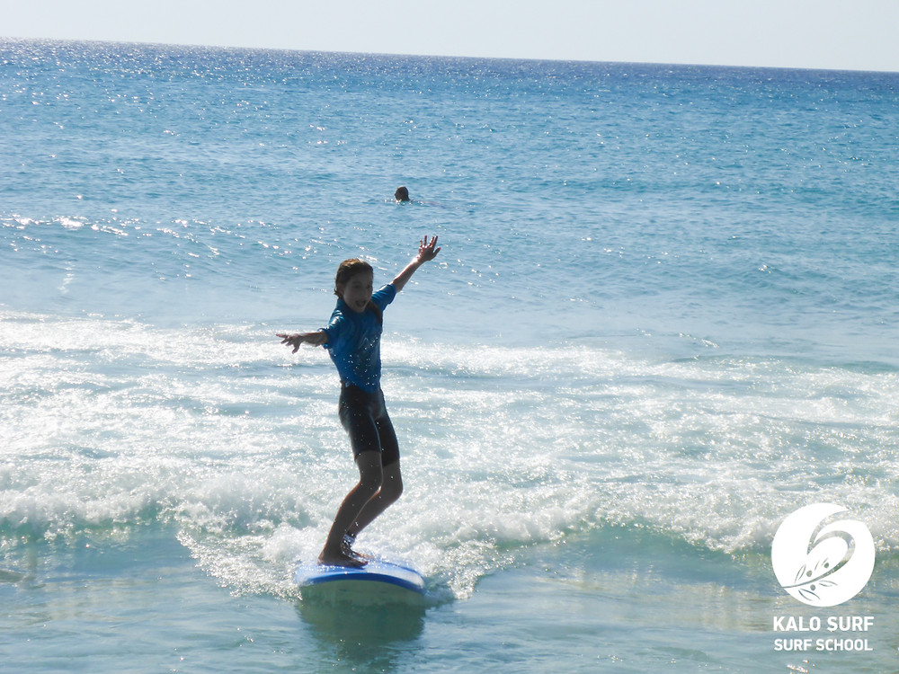 surfing a wave for the first time in Crete