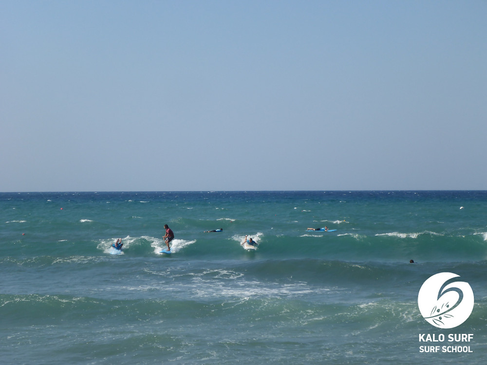 surfing waves in Crete