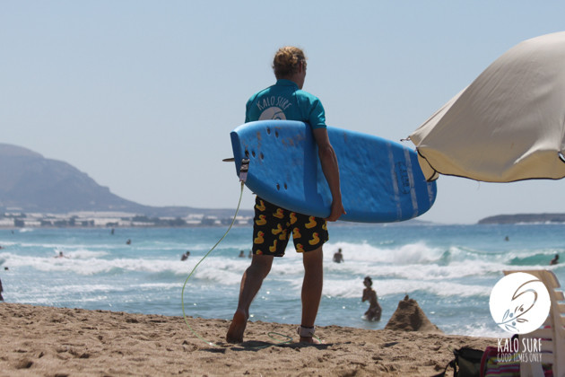 Surfer at west coast Crete