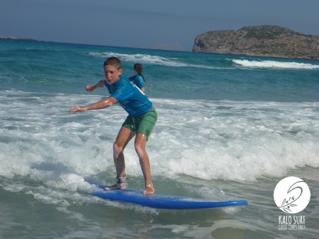 11 year old boy surfing in Greece
