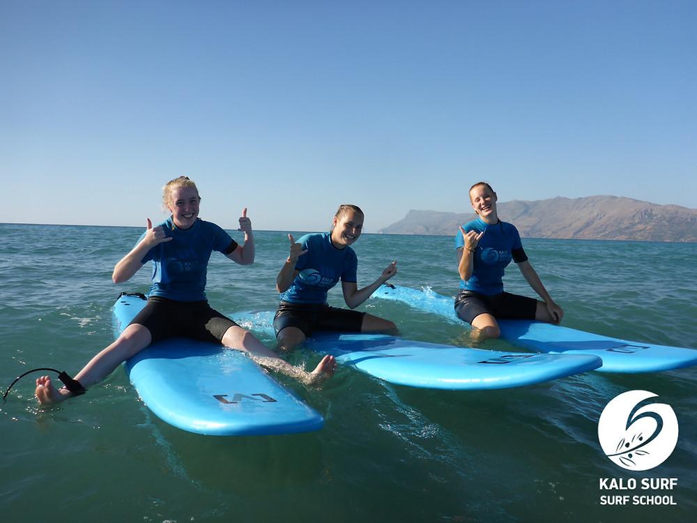 surfer girl, shaka, waves in Crete, Greece