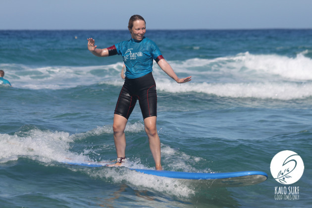 Girl surfing wave in Falassarna