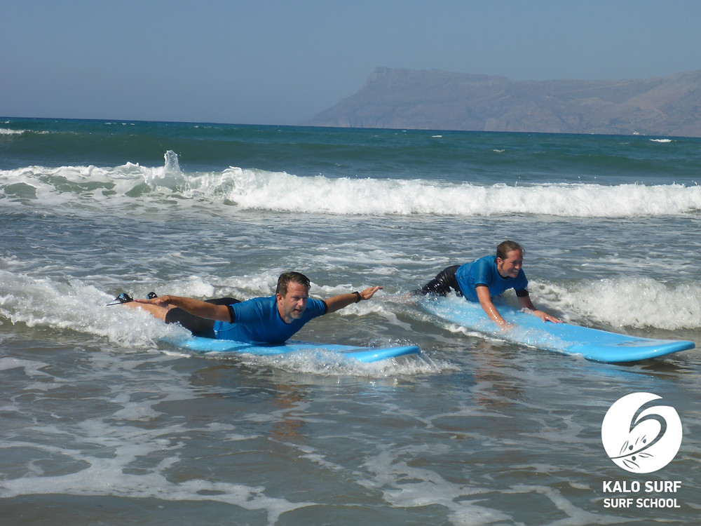 a couple catching a wave together in Crete