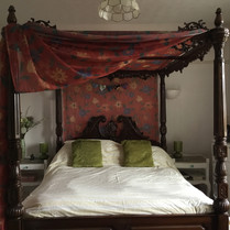 Red room with four poster bed