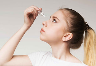 young-girl-using-disease-contact-eye-dro