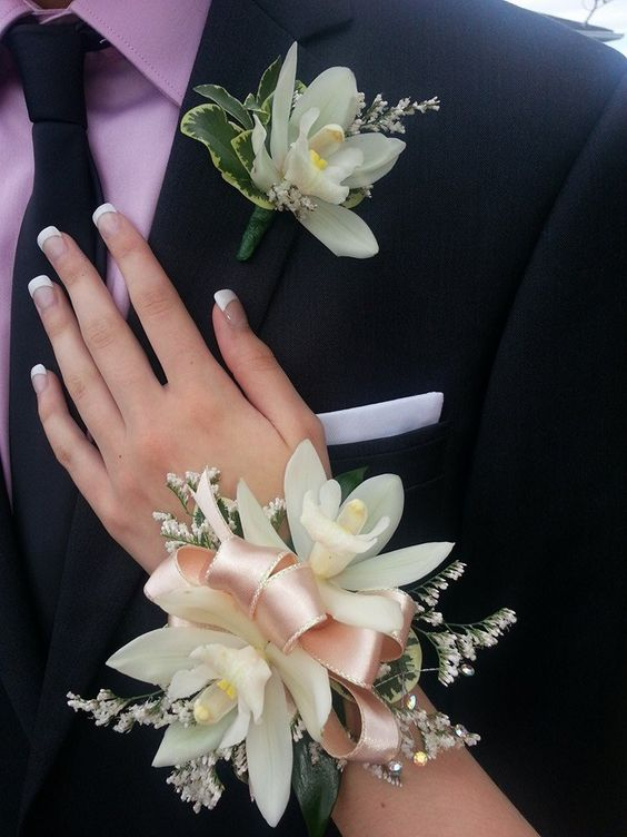 White Polymin Orchid Wrist Corsage and Buttin Hole.jpg