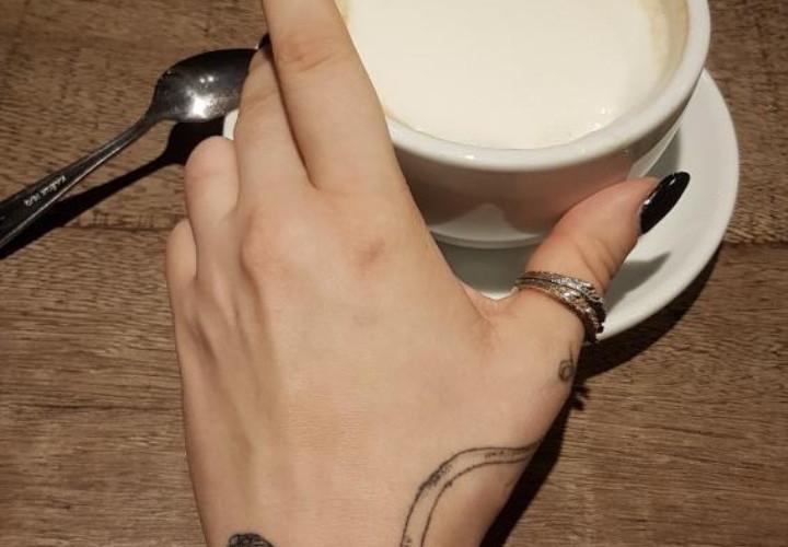 Illustrative fineline octopus hand tatto