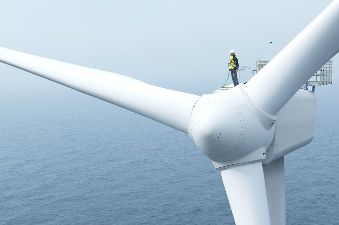 Man on a offshore turbine