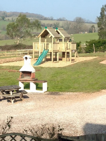 Kids Play area at Heron Cottage Newhouse Barton Devon