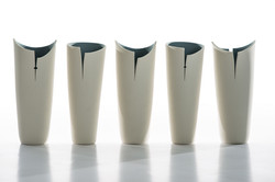 Cut and altered porcelain vases