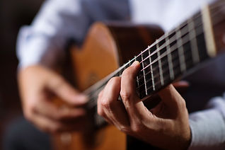 Classical guitar player. Selective focus