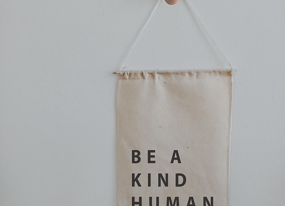 be a kind human banner