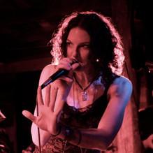 Jenn mic-hand up.jpg