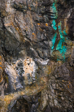 Rock Face with Green Copper