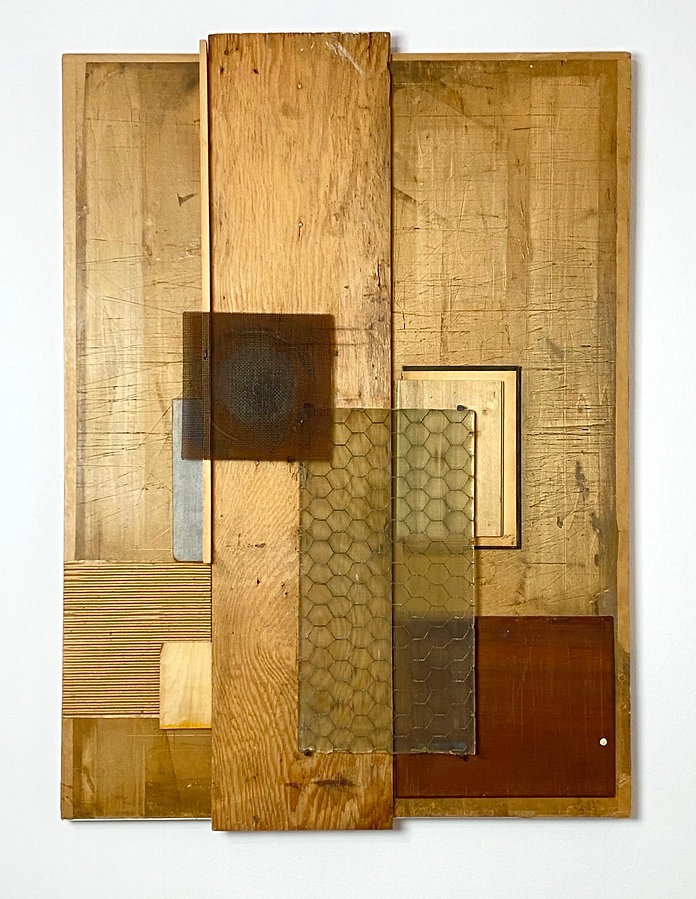 Assemblage of rough textured wood pieces, corrugated cardboard, rusted metal screen with round image, vintage book covders and wire mesh glass panel