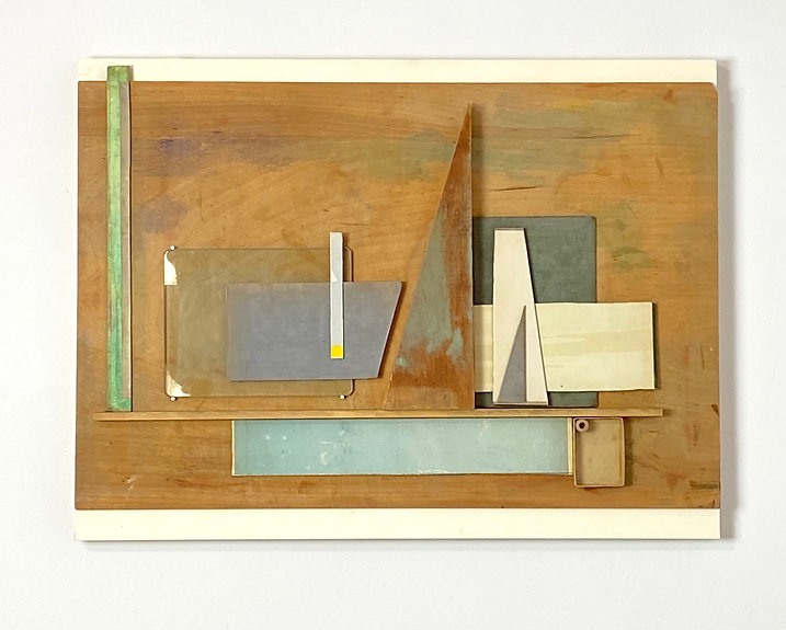 Found Object Assemblage with Random Greenish Blue Stained Background on Raw Wood, Book Cover Pieces, Wood Scraps, Pasteboard Matchbook Insert, Wood Resembling a Sailboat
