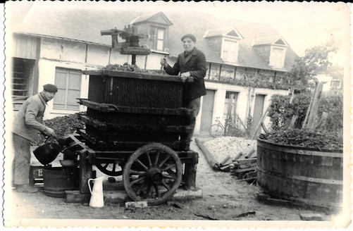 Grand-father (left) & GrandGrand-Father (right), crushing apple from the orchard to do cider and calvados