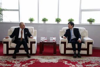 CMEC CFO and Board Secretary Zhou Yamin receive CEO Kaher TAHAT