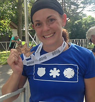 picture of Tanya holding medal