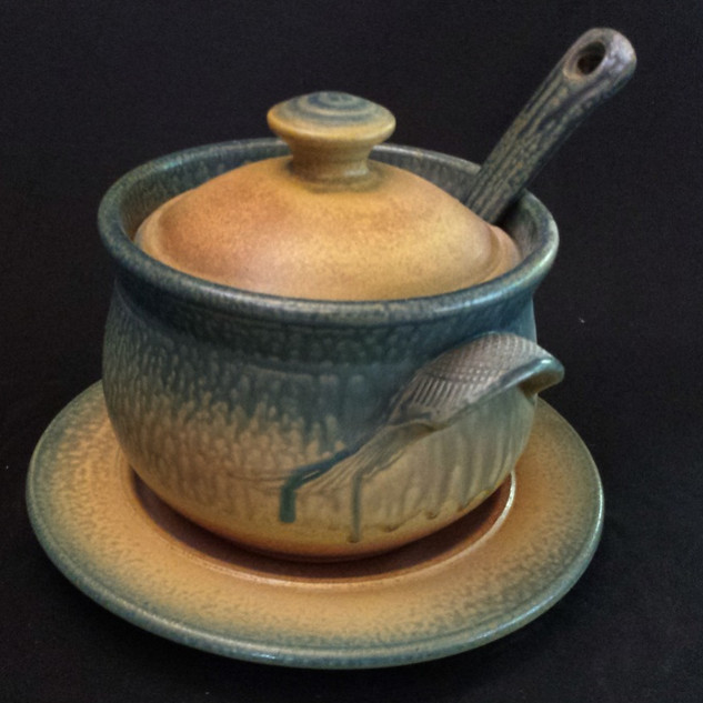 Soup tureen with plate and ladle