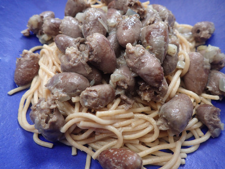 Chicken hearts served over multi grain pasta with a gunion sauce