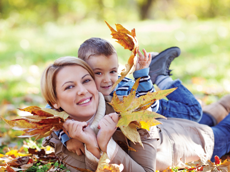 Mom_and_Young_Son_in_Leaves.jpg