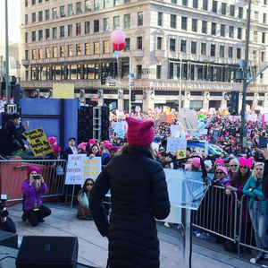 Co-founder of the Pussyhat Project, Jayna Zweiman speaking to the crowds in Los Angeles