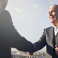 man-in-black-suit-shaking-hands-with-ano